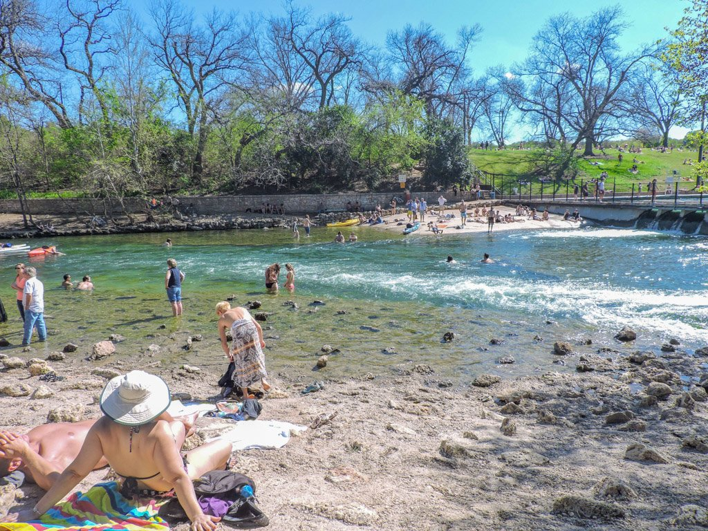 Barton Springs sunbathing blue skies