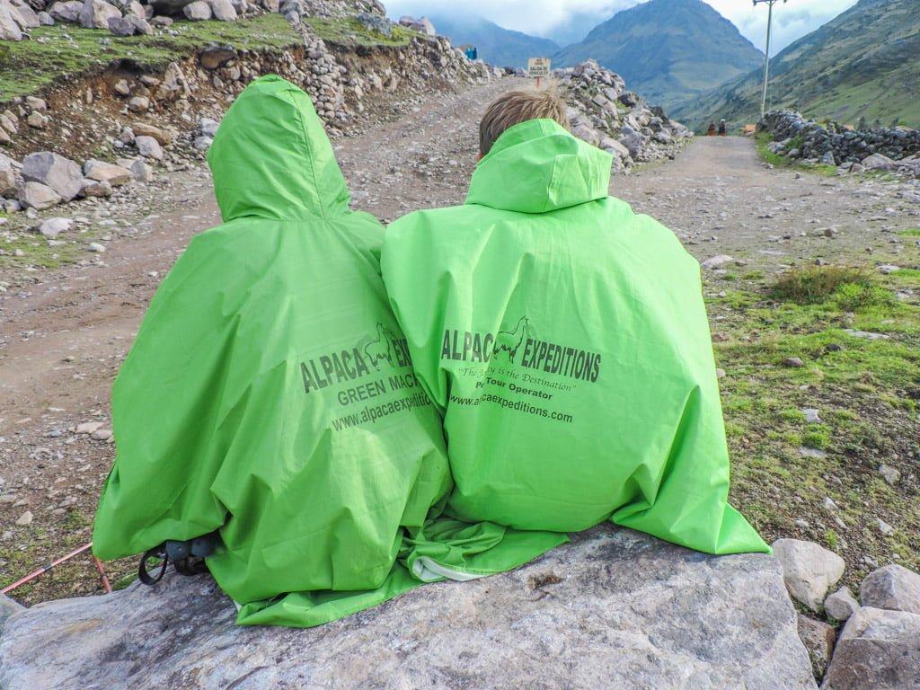 Couple wearing ponchos Lares Trek