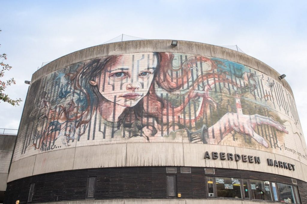 Aberdeen Nuart haunting girl mural looks down on city