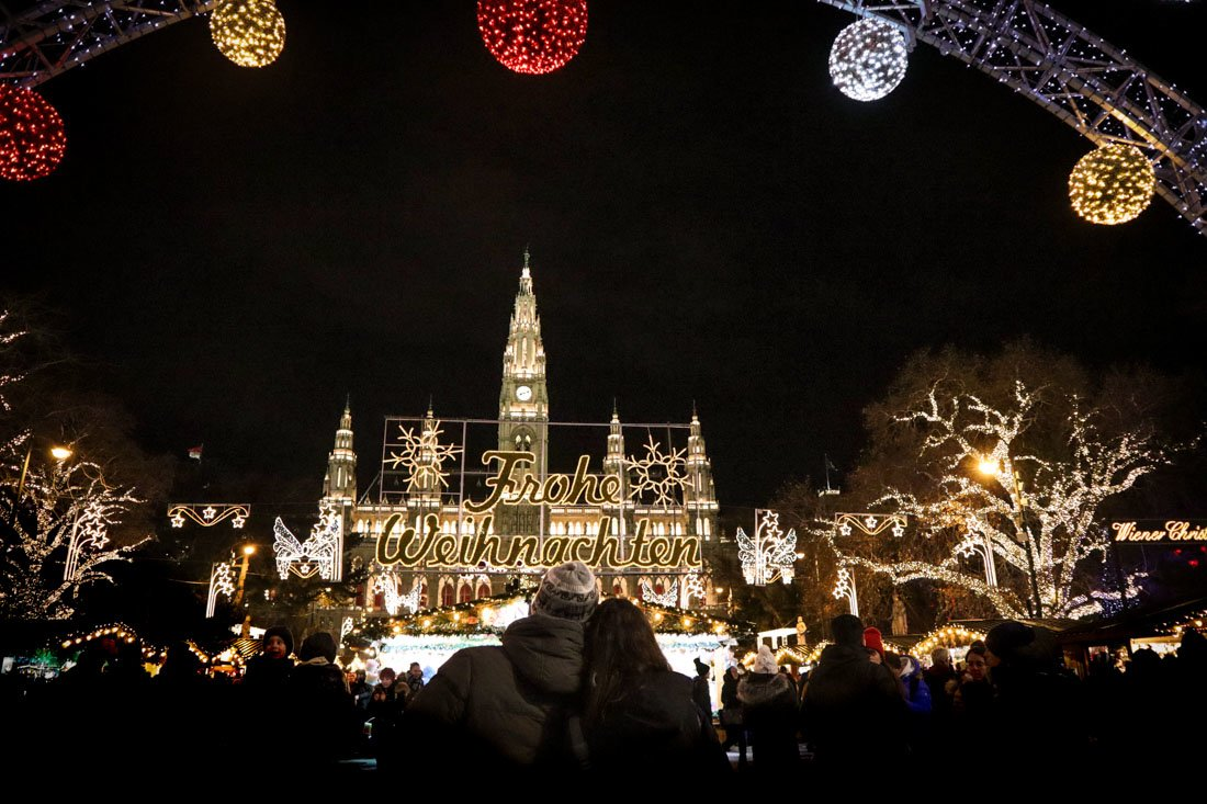 Couple cuddling at Christmas Markets Vienna Austria