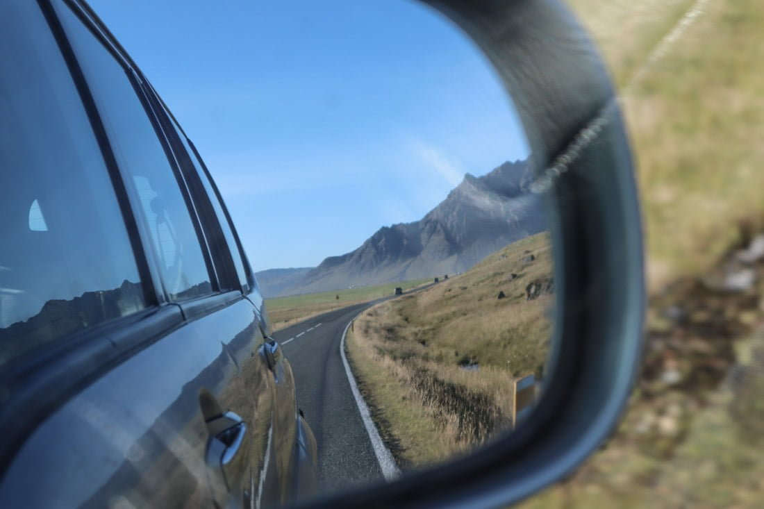 Road trip packing list - car mirror Iceland
