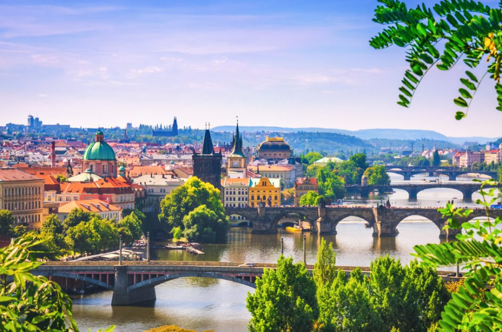 Prague Scenic view on bridges over Vltava river in Prague city. Charles bridge (Karluv Most) and old historical buildings, Czech Republic