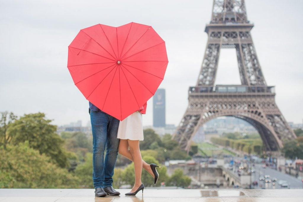 Red heart umbrella, couple kissing, romantic Eiffel Tower