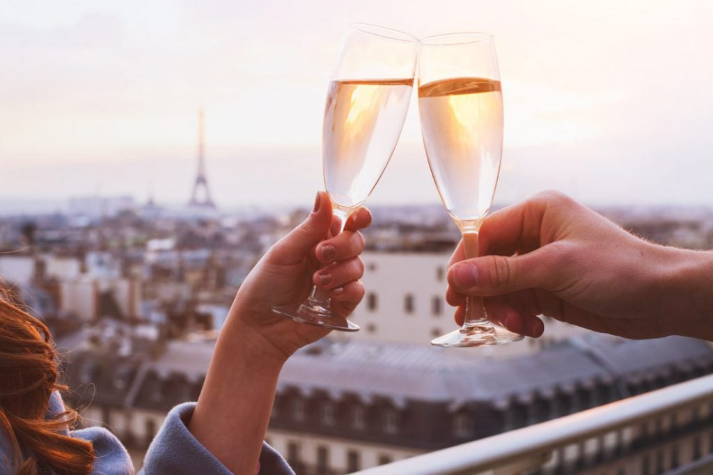 Wine glasses, romantic couple vacation Paris