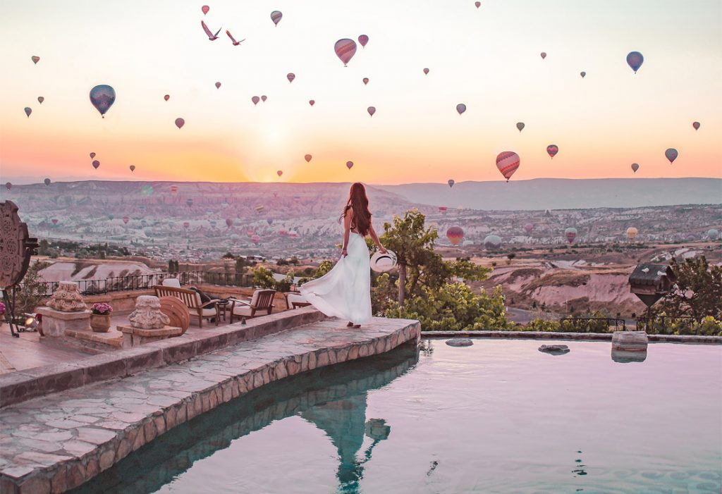 Woman, white dress, swimming pool, hot air balloons, sunrise, Cappadocia Museum Hotel