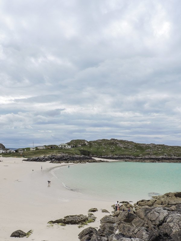 Achmelvich beach, sea, white sand, rocks, people North Coast 500 Scotland