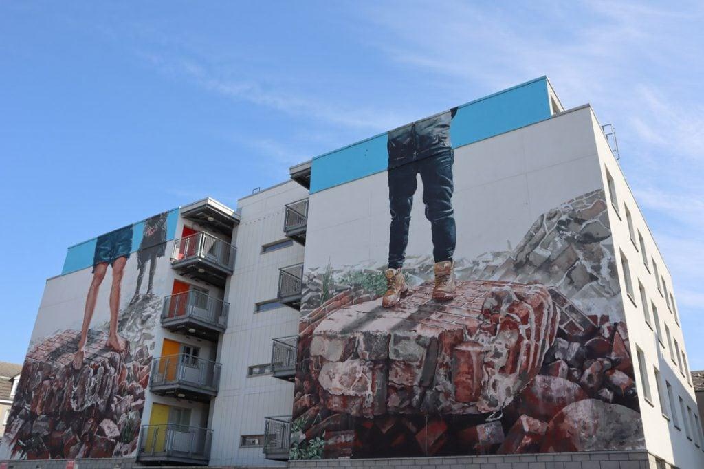 Fintan Magee legs standing on broken walls print Nuart Aberdeen
