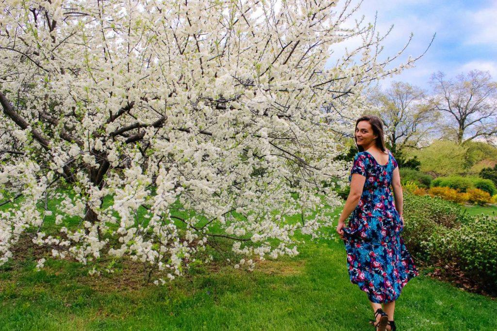 Girl in dress, walking in garden