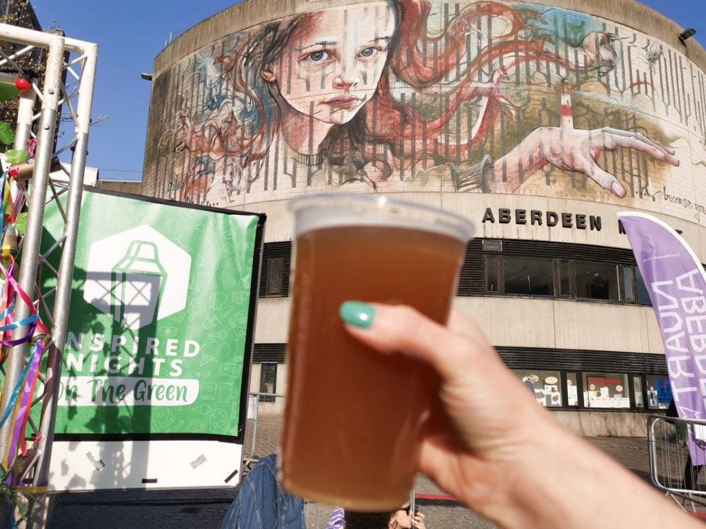 Inspired Nights Aberdeen Nuart beer, hand, mural