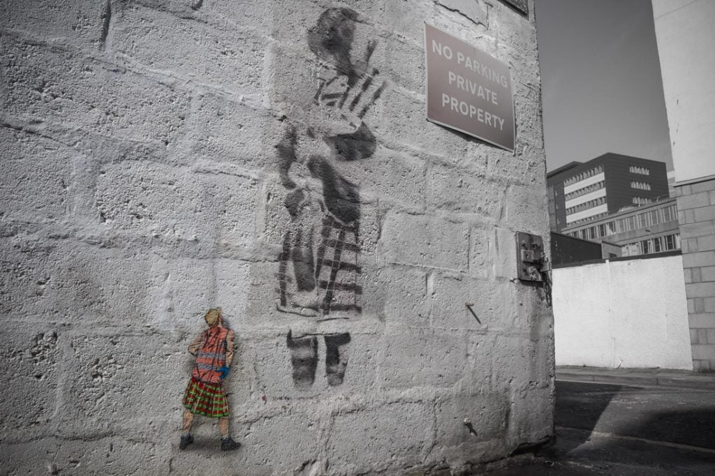 Jaune mural of small sanitation worker next to piper stencil Nuart Aberdeen_