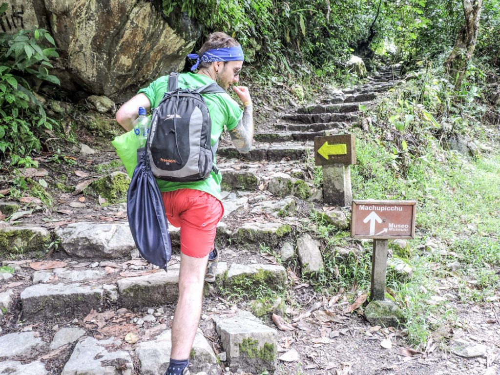 Machu Picchu hike, Craig, shorts, tshirt, day bag