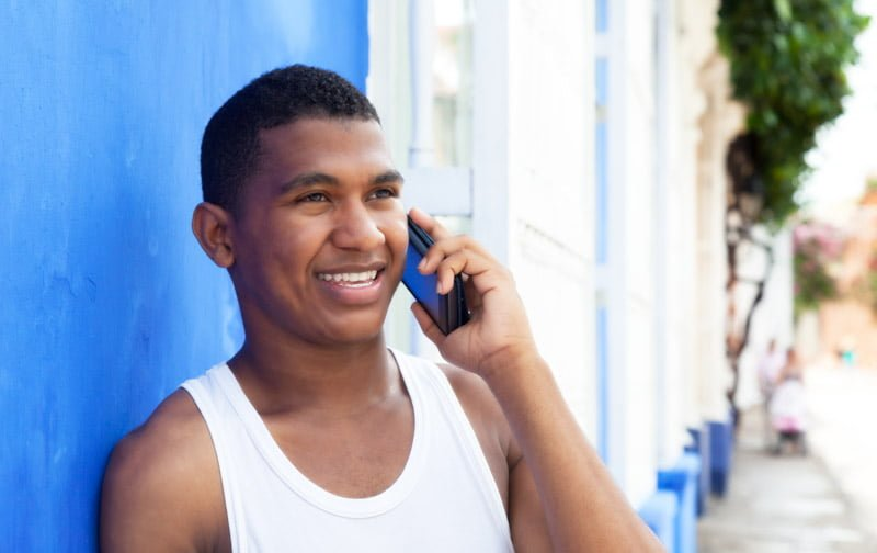 Man on phone in Cuba