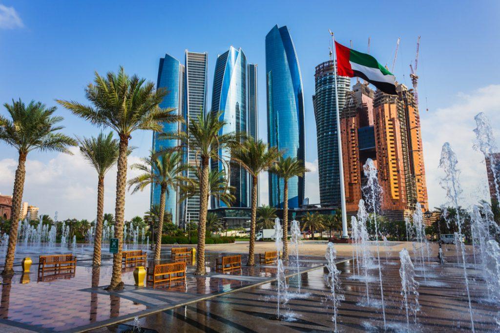Abu DhabiSkyline, trees, buildings, water fountain