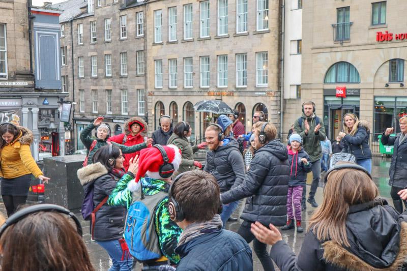 Silent Disco Adventure Christmas Tour, people dancing with headphones in Edinburgh_