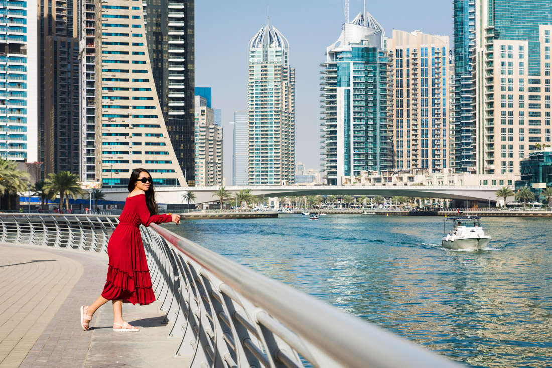 Girl in red dress with Dubai skyline