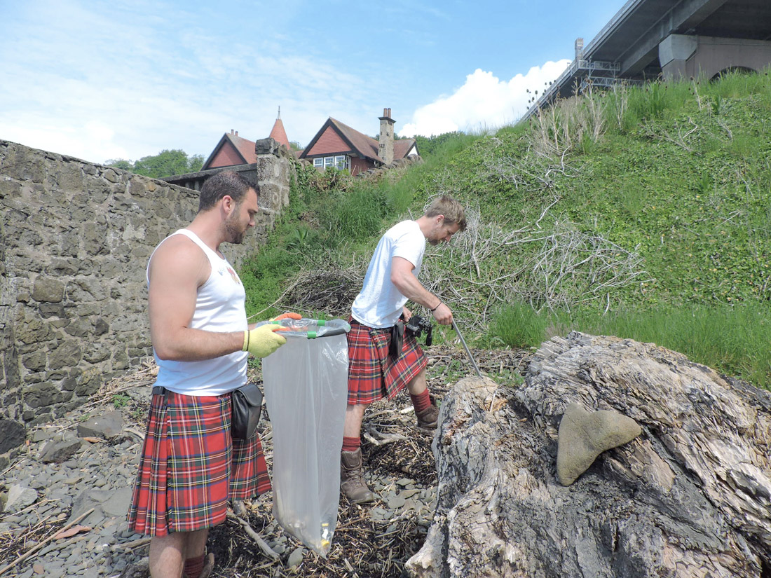 The Kilted Coaches in Fife at beach clean
