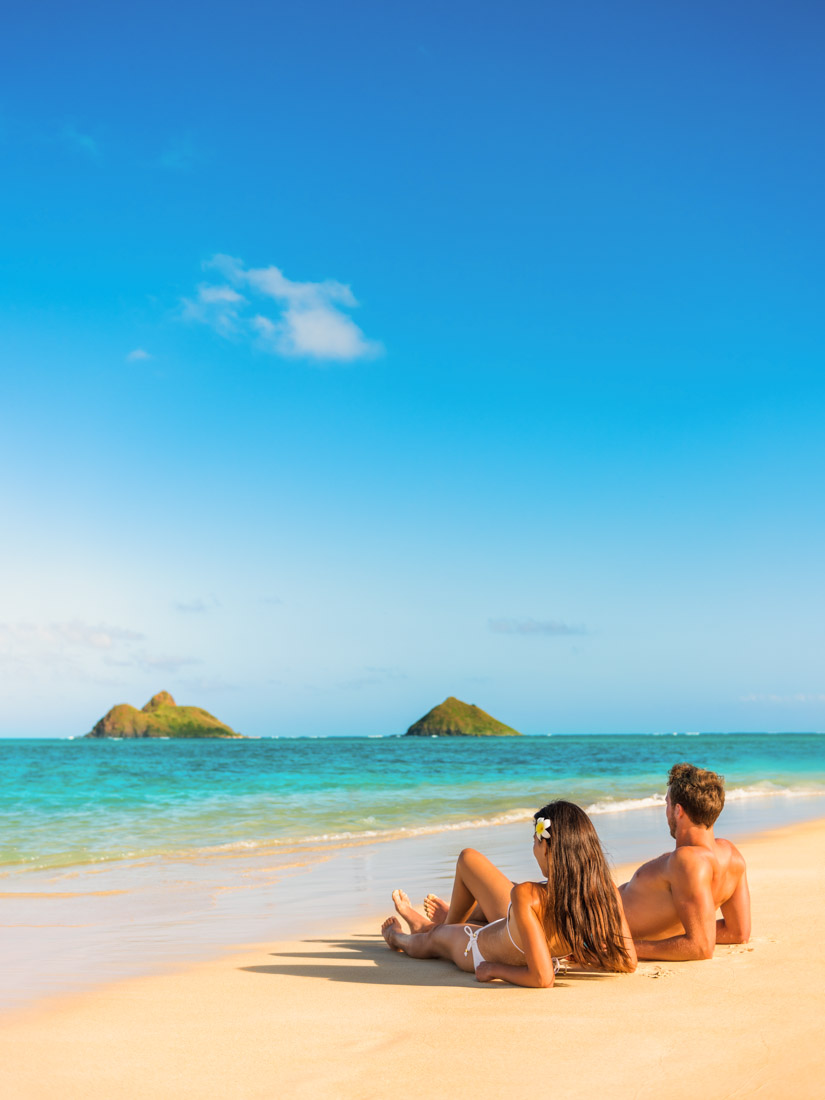couple relaxing on the beach in Hawaii