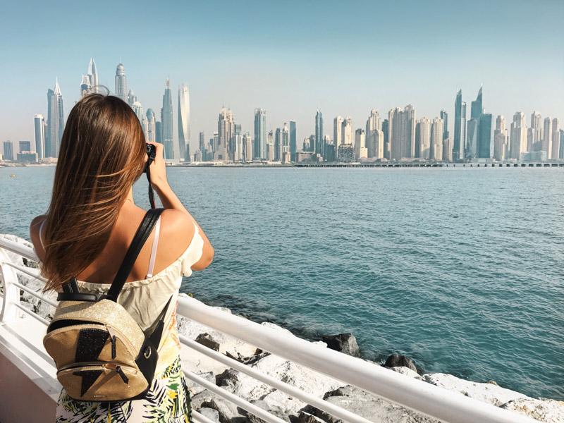 Dubai Skyline Woman Taking Photos