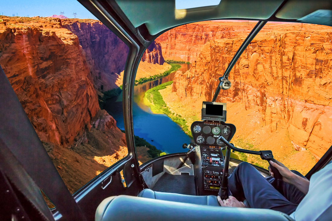 view of the Grand Canyon from a helicopter cockpit