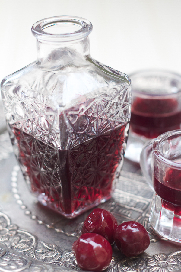 visnjevaca or sour cherry liqueur in a glass bottle with glasses