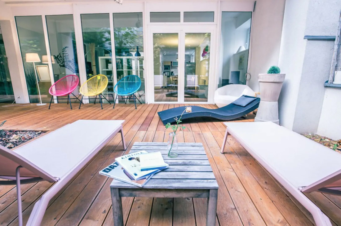 Trendy Loft With Urban Patio Summer Chairs