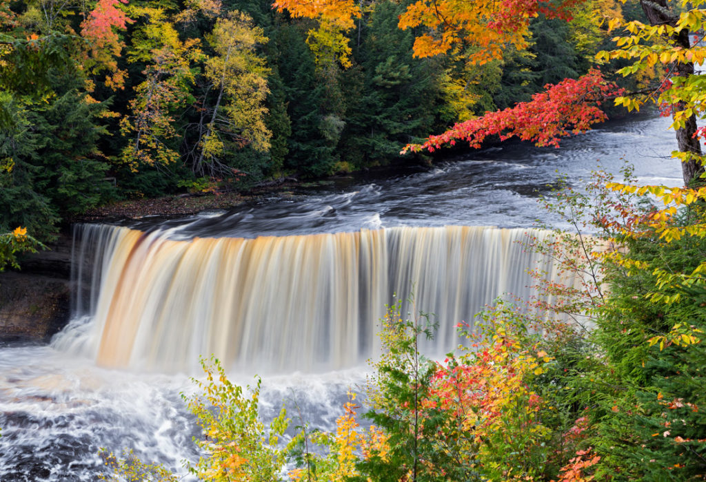 Michigan Tahquamenon falls with fall leaves on trees