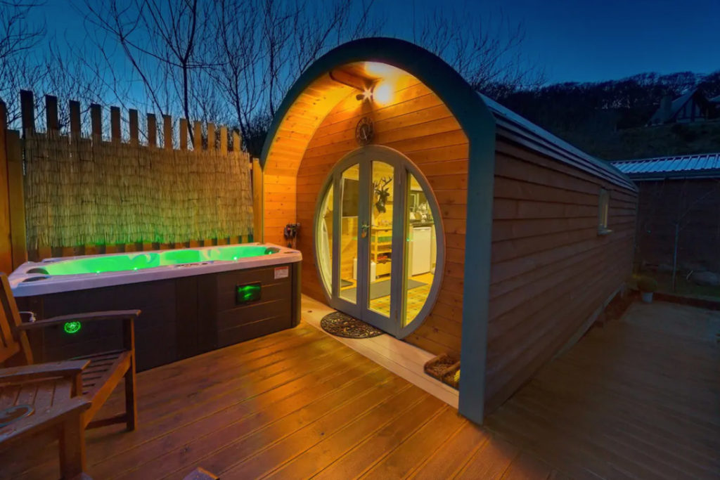 Hot tub next to wooden pod